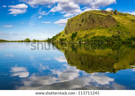 The majestic view of the lake in the mountains - stock photo