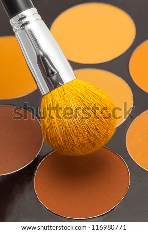 The makeup brush and cosmetic powder - stock photo