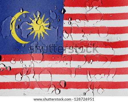 The Malaysia flag  covered with water drops - stock photo