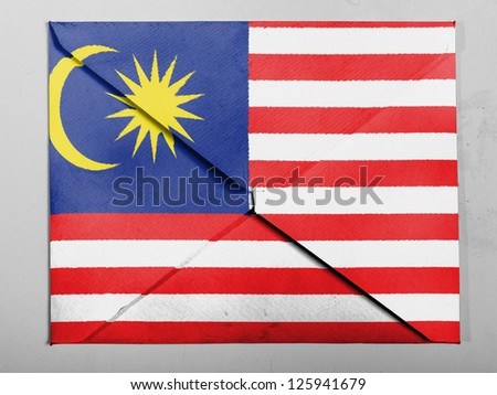 The Malaysia flag  painted on grey envelope - stock photo