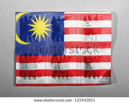 The Malaysia flag  painted on pills - stock photo