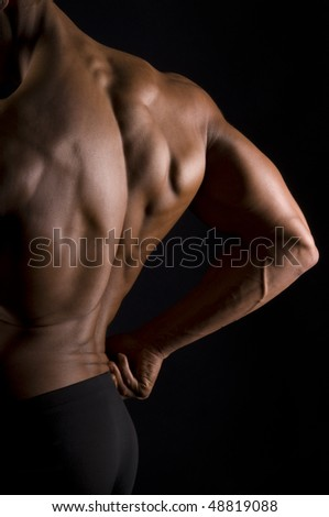 The male back on black background. - stock photo