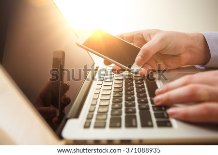 The male hand holding a phone  - stock photo