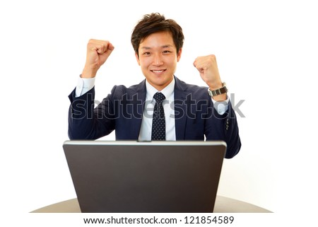 The male office worker who poses happily - stock photo