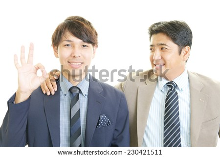 The male office workers who poses happily
