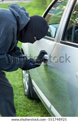 The malefactor in the mask stealing car