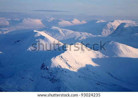 The Mamore mountains in midwinter, seen from the summit of Ben Nevis, Scotland.