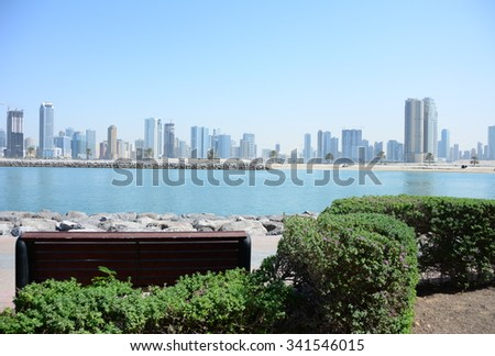 The Mamzar park in Dubai is a serene place to watch the Sharjah skyline  - stock photo