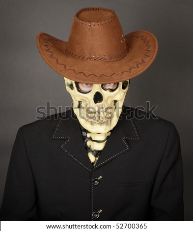 The man - a skeleton in a leather cowboy hat - stock photo