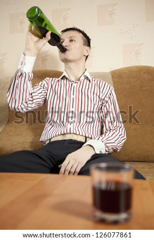 The man and the problem of alcohol. - stock photo