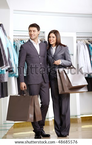 The man and the woman in suits in shop
