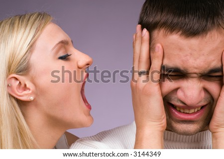 The man and the woman swear on a grey background - stock photo