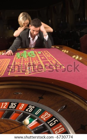 The man and woman have lost in a casino - stock photo