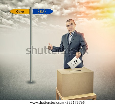 The man at the ballot box voting - stock photo