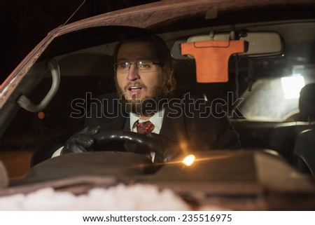 The man at the wheel the car - stock photo