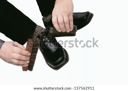 The man cleans boots - stock photo