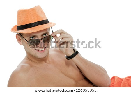 The man crafty looks atop of glasses - stock photo