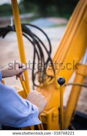 the man driving Excavator or Backhoe - stock photo