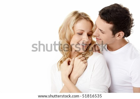 The man embraces the girl on a white background - stock photo