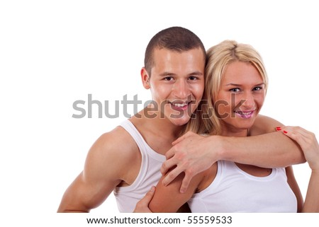 The man embraces the girl on a white background
