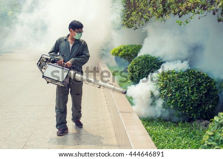 The man fogging to eliminate mosquito for prevent spread dengue fever - stock photo