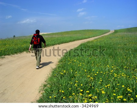The man going on a country road - stock photo