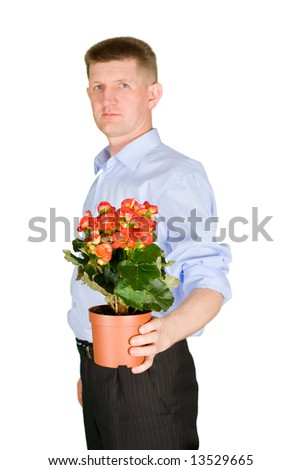 The man hides a beautiful flower behind a back