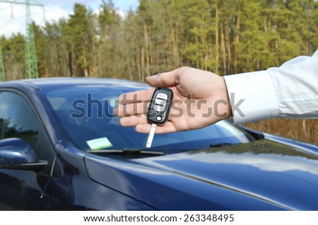 the man holds the keys of the machine - stock photo