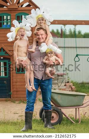 The man holds three children - stock photo