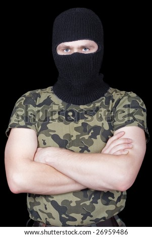 The man in a black mask over black - stock photo