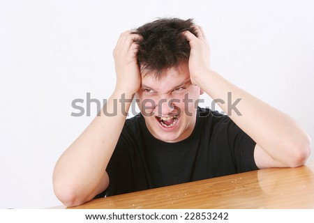 The man in a black vest keeps hands for a head and shouts - stock photo