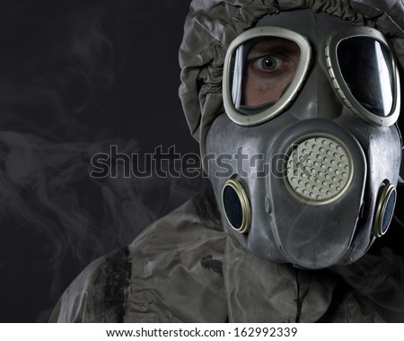 The man in a gas mask in smoke