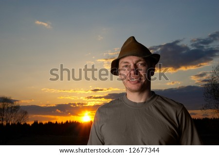 The man in a hat - stock photo