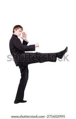 The man in a kimono practicing kung fu. Master rack direct stroke foot. Fighter isolated on white background. Concept of healthy life and martial arts.
