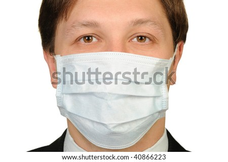 The man in a medical mask. It is isolated on a white background