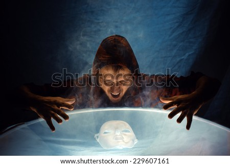 The man in a smoke above a mask  - stock photo