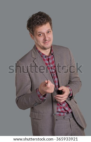the man in a stylish suit shows gesture of the account of money