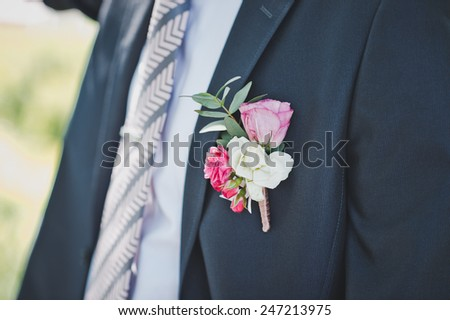 The man in a suit and with a buttonhole. - stock photo