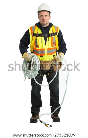 The man in a worker uniform and with building tools - stock photo