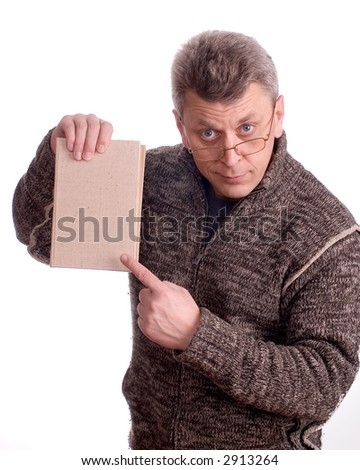 The man in glasses shows a finger on the book on a white background - stock photo