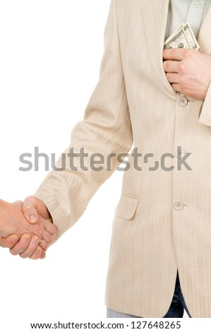the man in suit agreed about the bribe and puts it in his pocket money isolated on white background - stock photo