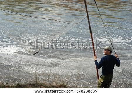 Man reeling fish back boat stock photo 2033804 shutterstock for Circle fishing boat
