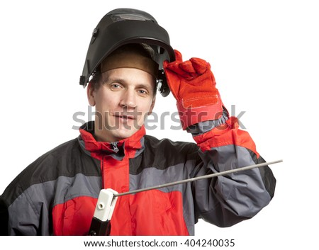 The man in working clothes and a welder mask - stock photo