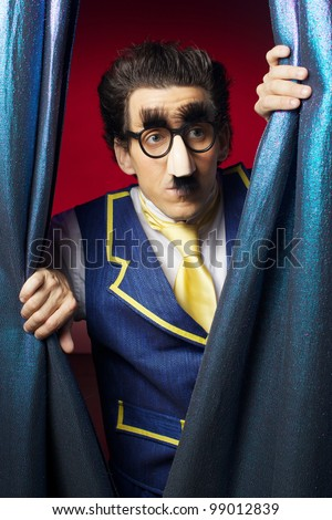 The man is looking through contain - stock photo