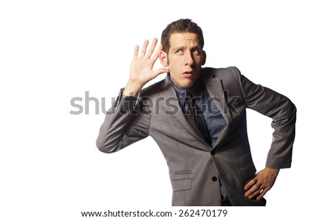 The man is offended and look at camera on white back ground  - stock photo