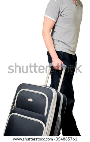 The man keeps a traveling bag on a white background in common clothes. The tourist with baggage on a white background. - stock photo