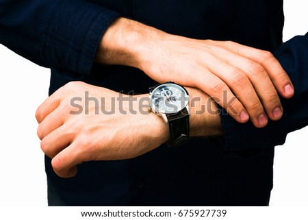 the man looking at his watch, isolated white background