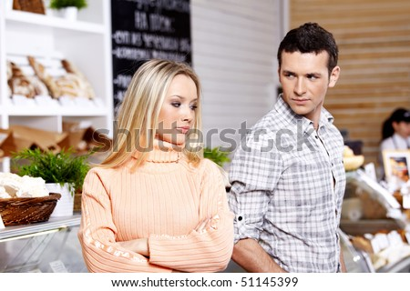 The man looks at the woman offended on it - stock photo