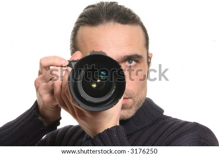 The man looks in a camera