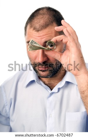 The man looks through a tube made of dollars.